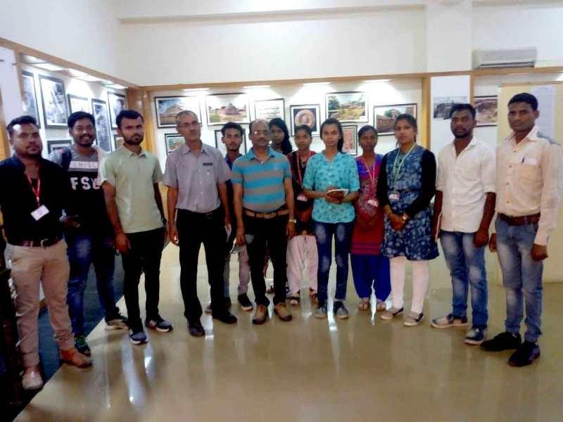 Students of Indira Gandhi National Tribal University see photo exhibition