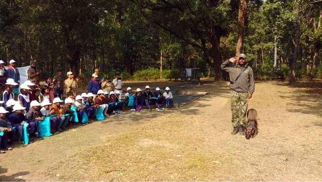 Children enjoy watching dog show and tiger at Kanha Tiger Reserve
