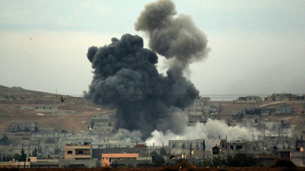 US-led air strike kills 57 in IS-held prison (Lead)