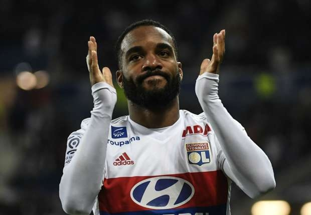 Arsenal sign French forward Lacazette for record fee