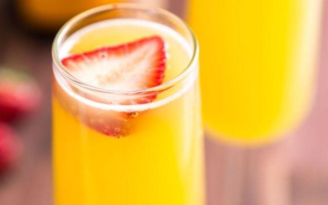 Pineapple Juice Mimosas with Strawberries