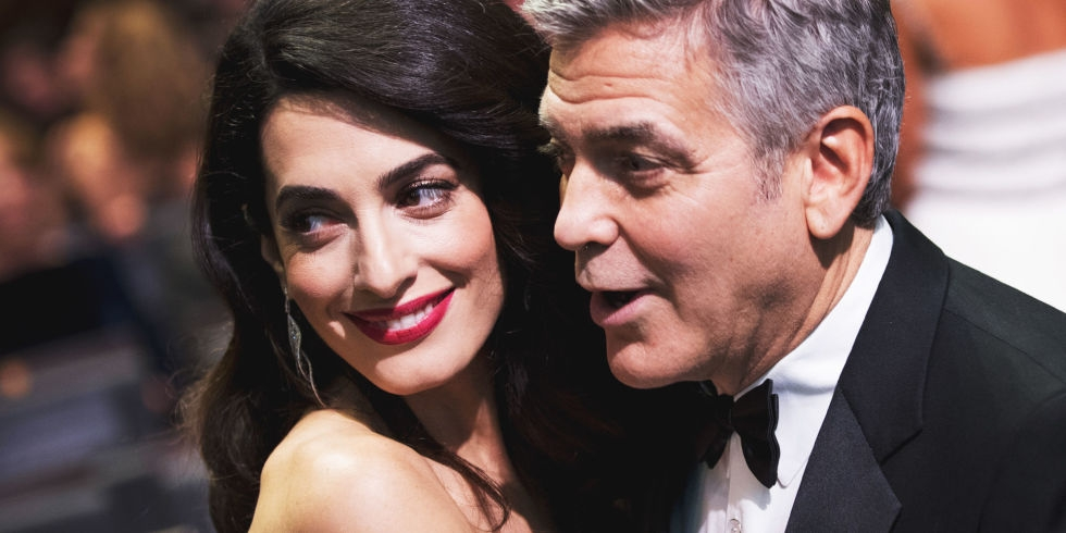 Paranoid George Clooney hit back at the paparazzi as he steals the glimpse of the twins illegally!