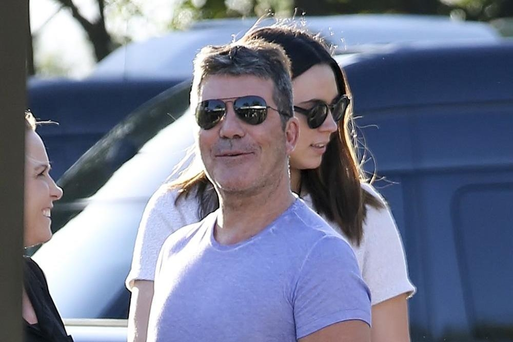 Cowell feel like a  proud dad  towards One Direction